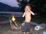 Our son by the beach bonfire at our summer cabin on the lake
